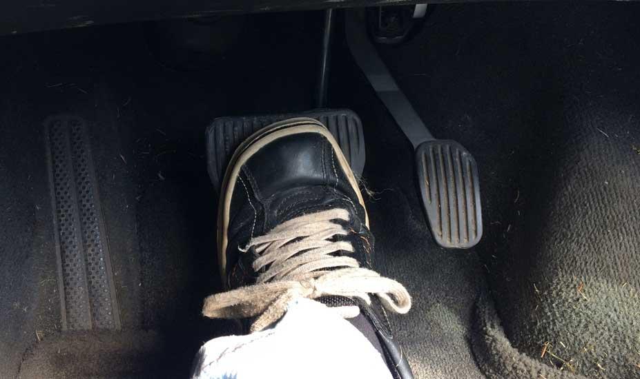 Holding down brake pedal