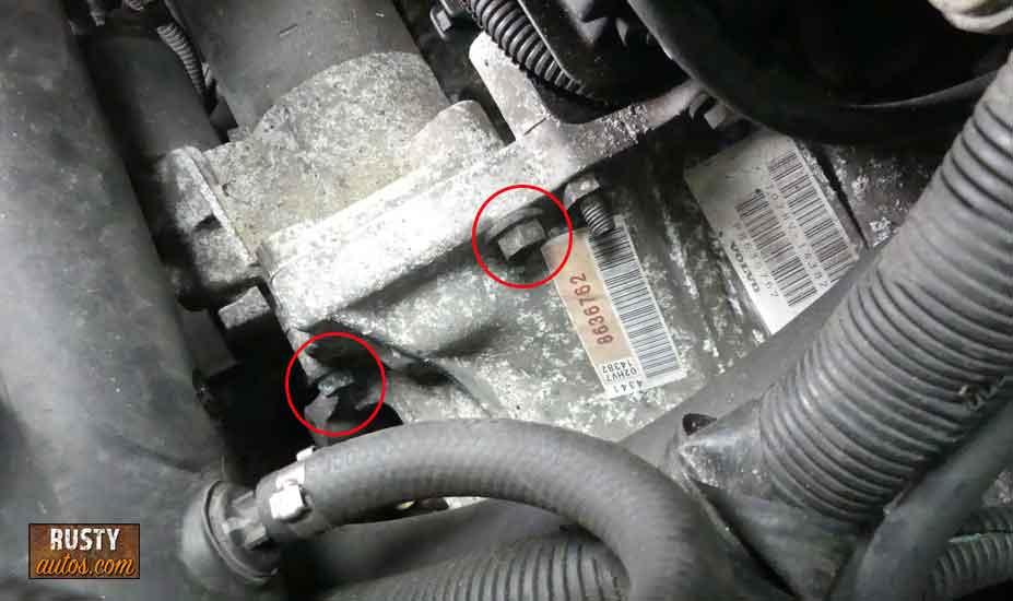 Remove starter motor bolts