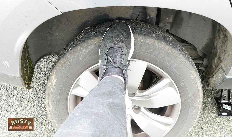 Kick stuck wheel to free it